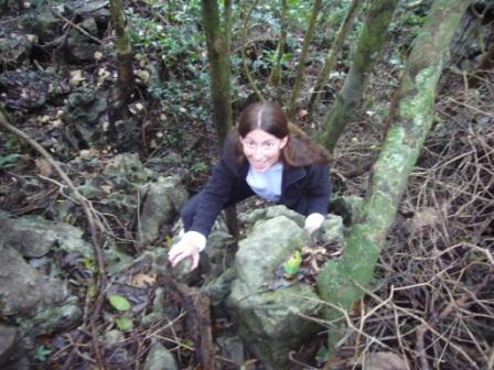 Lali climbing a rock in the Vietnamese jungle
