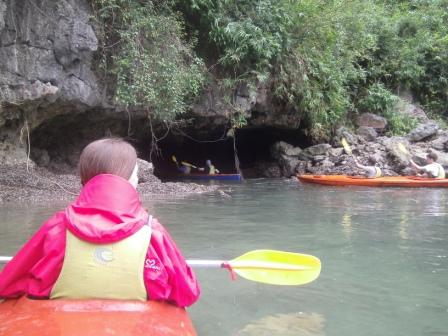 Lali kayaking in Halong Bay near the cave