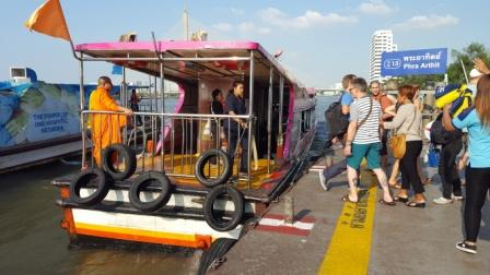 Getting on the general boat to cross the Chao Phraya river to visit the temples