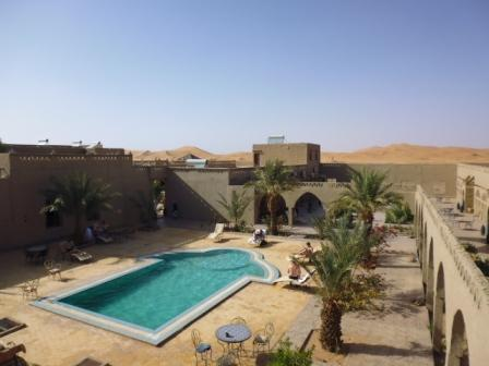 Hotel pool. See the desert dunes embracing the hotel